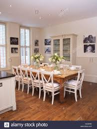 black table white chairs white chairs at simple wood table in modern white kitchen dining