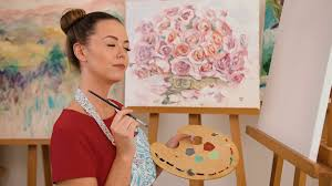 portrait of a young woman artist holding a brush and mix color oil