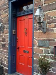 bunker red door with old knob style in navy door frame modern red