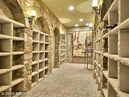 rustic wine cellar with brick floors u0026 built in bookshelf in