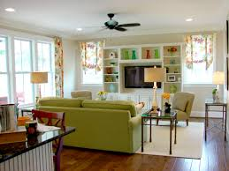 kitchen style fancy small living room design with green sofas and