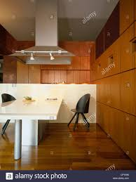 extractor fan over central island unit in contemporary kitchen