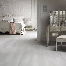 Laminate Bedroom Flooring Astonishing Grey Laminate Flooring Applied At Contemporary Bedroom