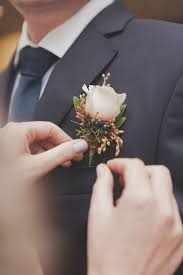 wedding boutonniere wedding traditions why does the groom wear a boutonniere seg