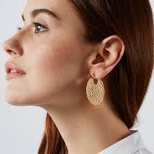 earing model hammered gold hoop earrings in a teacup jewellery