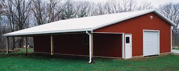 modern large pole barn garage kits with loft that has orange and