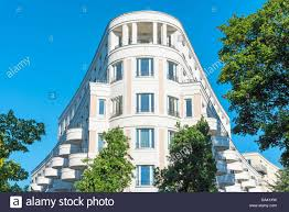modern white multi family house seen in berlin germany stock