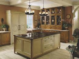 traditional kitchen cabinets with white kitchen stove and green