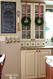 christmas in the kitchen glass cabinet doors preserved boxwood
