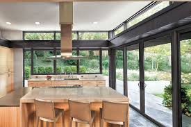 contemporary kitchen with kitchen island by marvin windows and