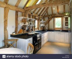 modern barn kitchen modern kitchen in barn conversion with exposed beams field place