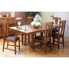 a america cattail bungalow solid wood trestle dining set in amber