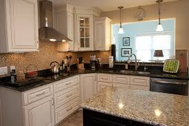 granite countertop painted grey cabinets delta faucets oil