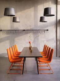 Grey Meeting Table Meeting Chair In Solid Orange Colour Against Wood