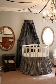 round canopy crib with chandelier and mirror and kids sofa