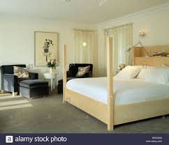 White Bedroom Grey Carpet White Linen On Pale Wood Bed In Modern Bedroom With Gray Carpet