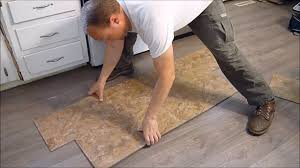 How To Put Laminate Flooring Down How To Install Vinyl Plank Flooring Snap Together Youtube