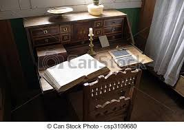 stock photography of very old desk with vintage open bible
