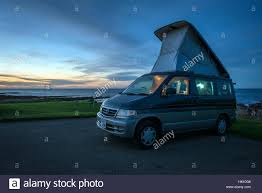 mazda bongo mazda bongo camper van with pop up roof camping next to the sea on