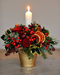 candle arrangements christmas centrepiece with flowers and berries pinteres