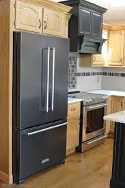 gray kitchen cabinets with black stainless steel appliances partial kitchen remodel with mixed metals