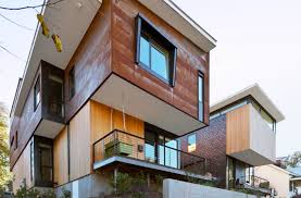 Compact Homes by Two Compact Modern Homes Fill Challenging Empty Lots In An Old