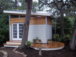 backyard studio with terraced living roof purple fountain tree