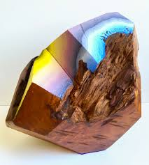 wood blocks carved and painted into glimmering gemlike objects by