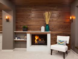 sleek basement remodeling idea with brick fireplace and wall tv
