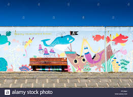 a colourful mural painted on the sea wall at canvey island in a colourful mural painted on the sea wall at canvey island in essex the mural is painted by canvey island infants school