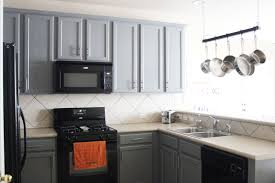 light grey kitchen cabinets with black appliances kitchen before and after gusto grace