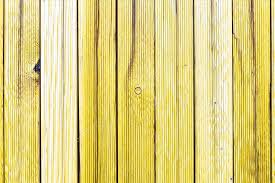 a fragment of an wooden fence painted wooden planks as a