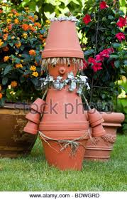 figure of man made of flower pots on display at garden store in
