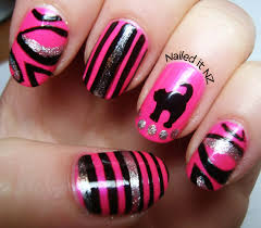 rainbow nails and a pink cat