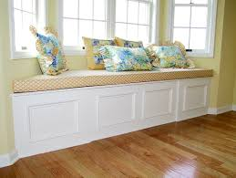 decor window seat with white bench and pattern bench cushions