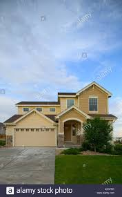 middle class two story home exterior denver colorado stock photo