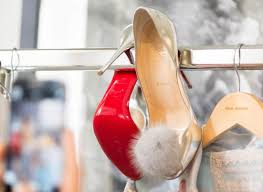 christian louboutin shoes topped with fur pompoms pursuitist
