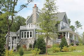 Farmhouse With Wrap Around Porch by Exteriors