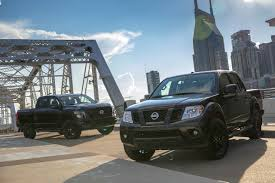 yellow nissan truck 2018 nissan frontier and nissan titan go dark with midnight