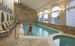 dazzling design indoor pool ideas with curve shape swimming