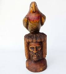 large carved wood rasta with parrot bird on jamaican