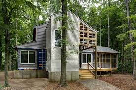 shipping containers integrated into dream retreat in the forest