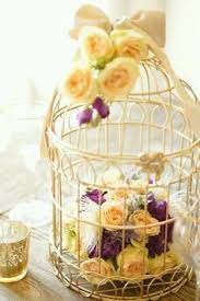 Decorative Bird Cages For Centerpieces by Baby U0027s Breath In A Birdcage For The Dinner Table U0027s Centrepiece