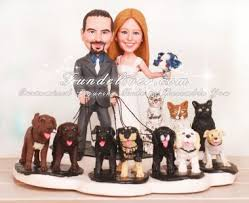 wedding cake topper with dog and cats wedding cake toppers with paw print base