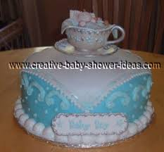 elegant baby boy shower cake with edible tea cup on top with baby