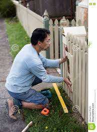 home renovator installing a new mailbox stock photo image 70716596