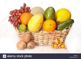 fruit in a basket fruit in a basket melons grapes oranges lime physalis