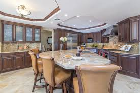granite kitchen countertop designs and styles angie s list kitchen with granite countertops and island seating