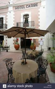 facade of the hotel caribe and outdoor restaurant tables merida