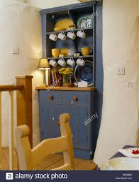 small blue dresser in alcove in cottage dining room stock photo